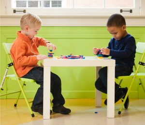 Kids Sitting at School Table Playing