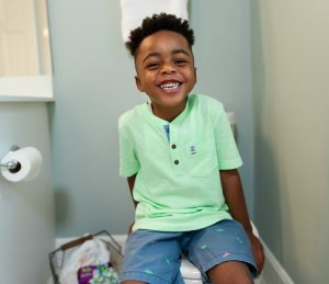 Smiling boy on potty