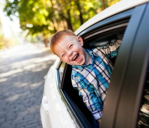 Kid Sticking Head Out of Car Window